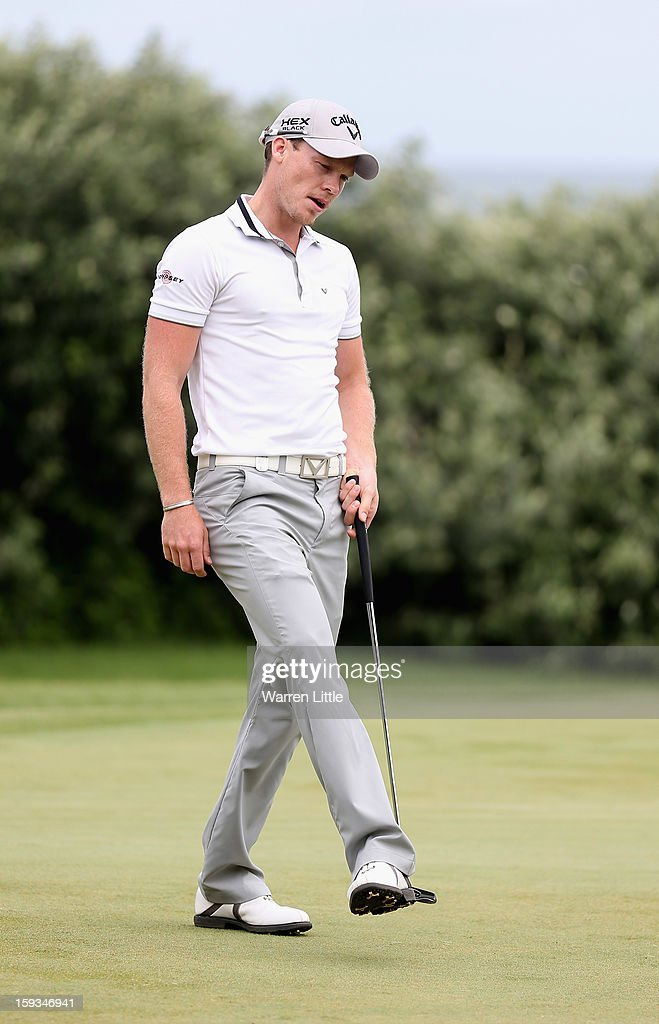 <a gi-track='captionPersonalityLinkClicked' href=/galleries/search?phrase=Danny+Willett&family=editorial&specificpeople=4488861 ng-click='$event.stopPropagation()'>Danny Willett</a> of England reacts to a missed putt on the first green during the third round of the Volvo Golf Champions at Durban Country Club on January 12, 2013 in Durban, South Africa.