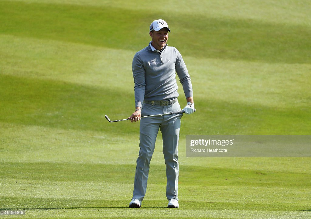 <a gi-track='captionPersonalityLinkClicked' href=/galleries/search?phrase=Danny+Willett&family=editorial&specificpeople=4488861 ng-click='$event.stopPropagation()'>Danny Willett</a> of England reacts to his 2nd shot on the 7th hole during day two of the BMW PGA Championship at Wentworth on May 27, 2016 in Virginia Water, England.