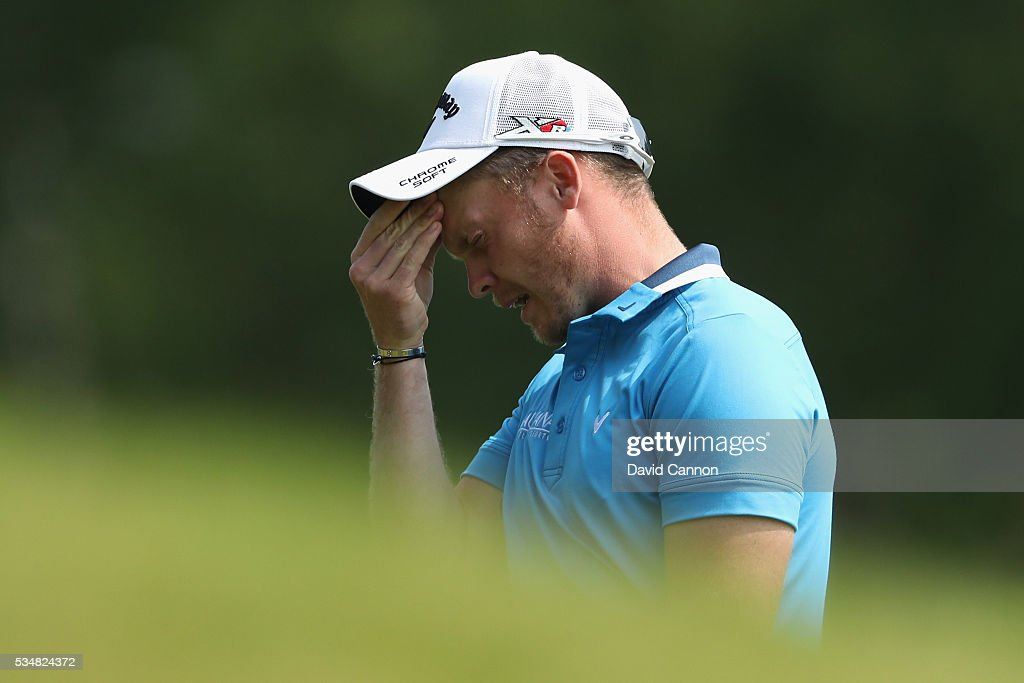 Danny Willett of England reacts to his 2nd shot on the 9th hole during day three of the BMW PGA Championship at Wentworth on May 28 2016 in Virginia...