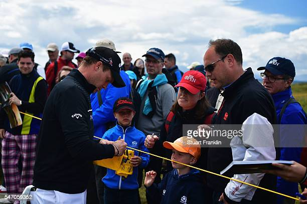 Danny Willett of England signs autographs for the fans during a practice round ahead of the 145th Open Championship at Royal Troon on July 13 2016 in...