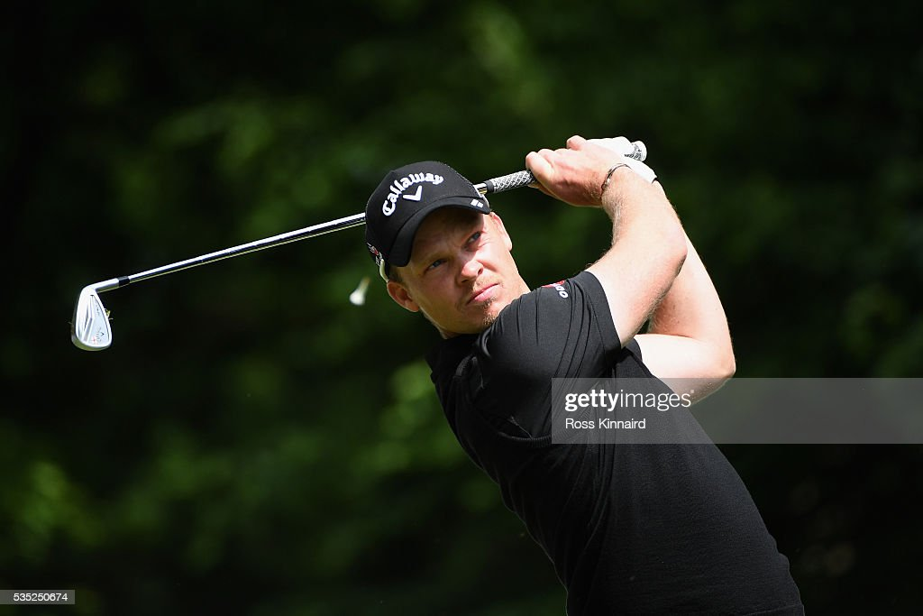 <a gi-track='captionPersonalityLinkClicked' href=/galleries/search?phrase=Danny+Willett&family=editorial&specificpeople=4488861 ng-click='$event.stopPropagation()'>Danny Willett</a> of England tees off on the 5ty hole during day four of the BMW PGA Championship at Wentworth on May 29, 2016 in Virginia Water, England.