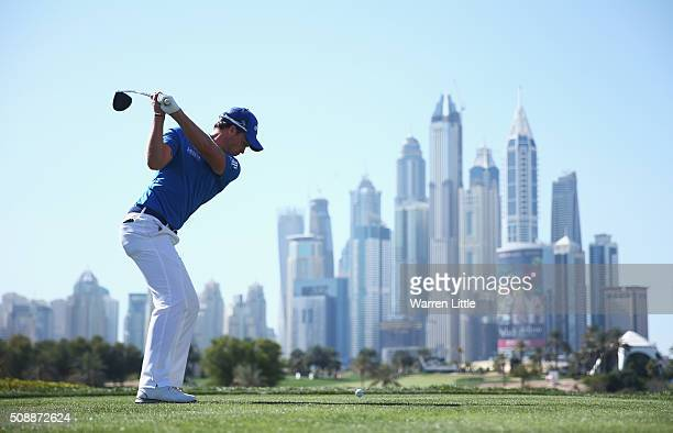 Danny Willett of England tees off on the 8th hole during the final round of the Omega Dubai Desert Classic at the Emirates Golf Club on February 7...