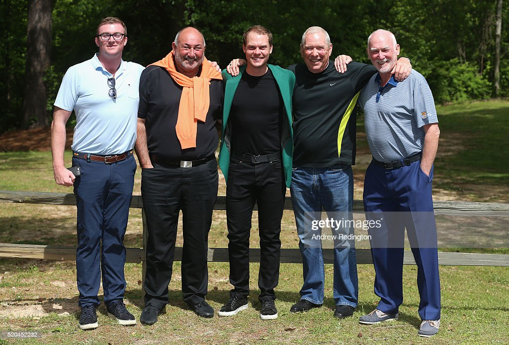 Danny Willett of England, the 2016 Masters champion, (centre) poses with members of his management team ISM (L-R) Nick Mullen, Andrew Chubby Chandler, Louis Martin and Martin Hardy at his rented house on April 11, 2016 in Augusta, Georgia.