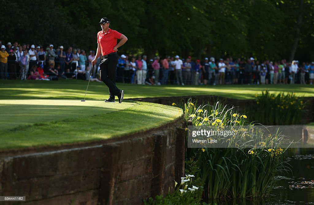 <a gi-track='captionPersonalityLinkClicked' href=/galleries/search?phrase=Danny+Willett&family=editorial&specificpeople=4488861 ng-click='$event.stopPropagation()'>Danny Willett</a> of England waits on the 18th green during day one of the BMW PGA Championship at Wentworth on May 26, 2016 in Virginia Water, England.
