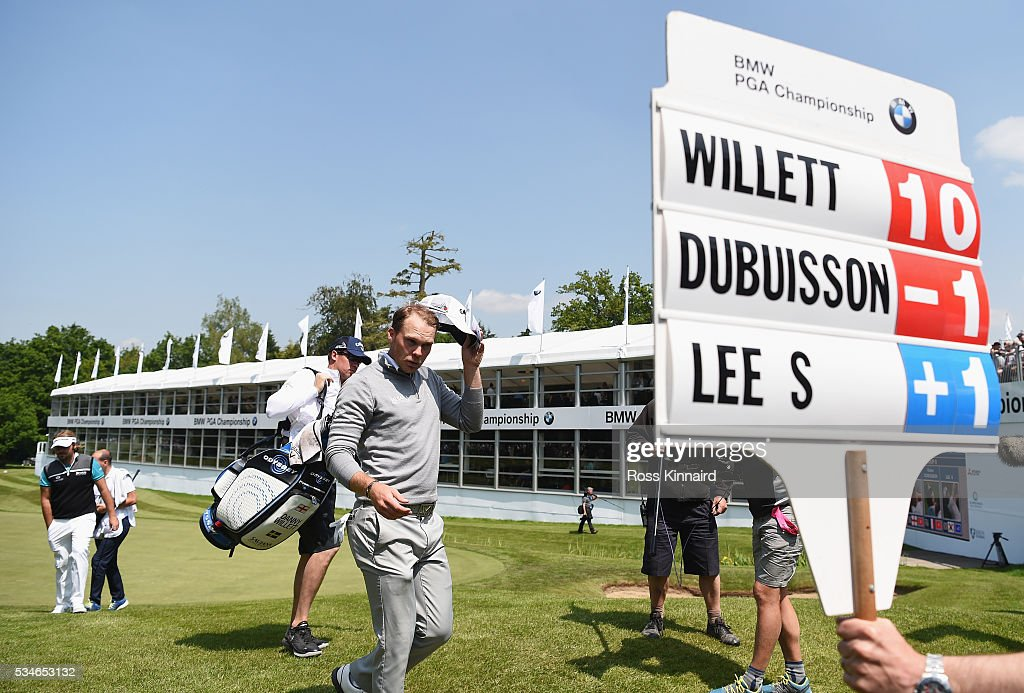 <a gi-track='captionPersonalityLinkClicked' href=/galleries/search?phrase=Danny+Willett&family=editorial&specificpeople=4488861 ng-click='$event.stopPropagation()'>Danny Willett</a> of England walks off the 18th green during day two of the BMW PGA Championship at Wentworth on May 27, 2016 in Virginia Water, England.
