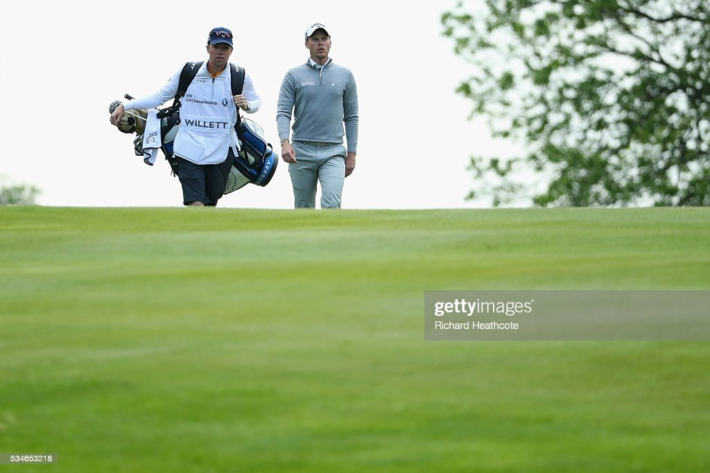 <a gi-track='captionPersonalityLinkClicked' href=/galleries/search?phrase=Danny+Willett&family=editorial&specificpeople=4488861 ng-click='$event.stopPropagation()'>Danny Willett</a> of England walks with his caddie Jonathan Smart during day two of the BMW PGA Championship at Wentworth on May 27, 2016 in Virginia Water, England.