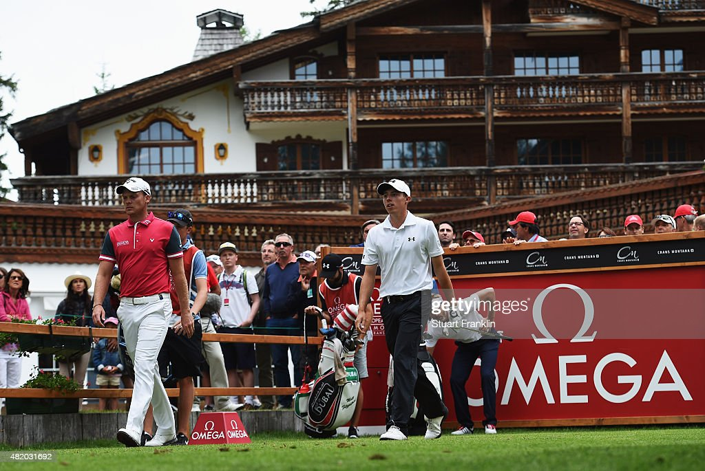 Danny Willett of England walks with Matthew Fitzpatrick of England during the final round of the Omega European Masters at CranssurSierre Golf Club...