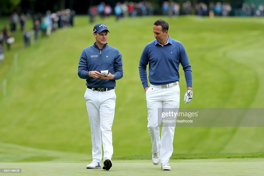 <a gi-track='captionPersonalityLinkClicked' href=/galleries/search?phrase=Danny+Willett&family=editorial&specificpeople=4488861 ng-click='$event.stopPropagation()'>Danny Willett</a> of England walks with <a gi-track='captionPersonalityLinkClicked' href=/galleries/search?phrase=Michael+Vaughan&family=editorial&specificpeople=179446 ng-click='$event.stopPropagation()'>Michael Vaughan</a> (R) during the Pro-Am prior to the BMW PGA Championship at Wentworth on May 25, 2016 in Virginia Water, England.