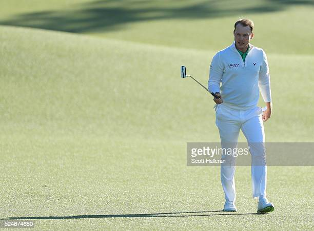 Danny Willett of England waves to the gallery on the 18th hole during the final round of the 2016 Masters Tournament at the Augusta National Golf...