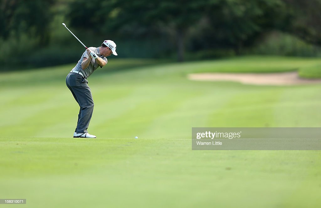 Danny Willetts of England plays his second shot into the 13th green during the first round of the Alfred Dunhill Championship at Leopard Creek Country Golf Club on December 13, 2012 in Malelane, South Africa.