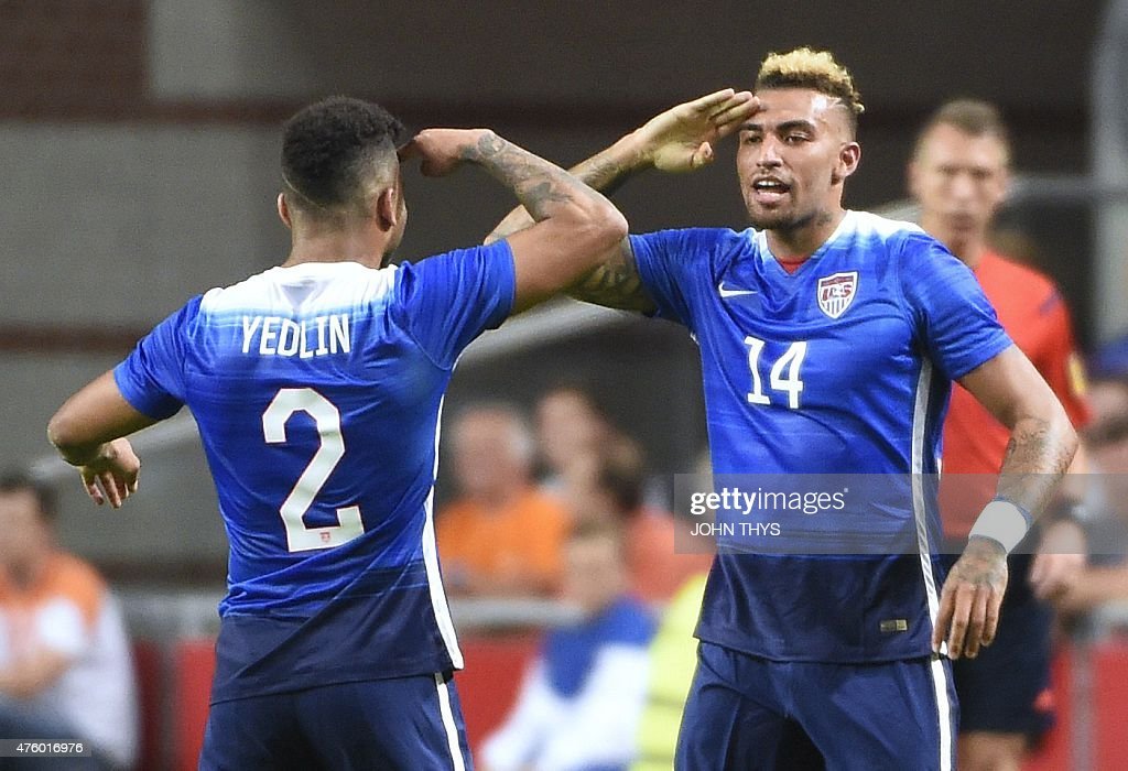 US Danny Williams celebrates with US DeAndre Yedlin after scoring a goal during the friendly football match between the Netherlands and USA on June 5...