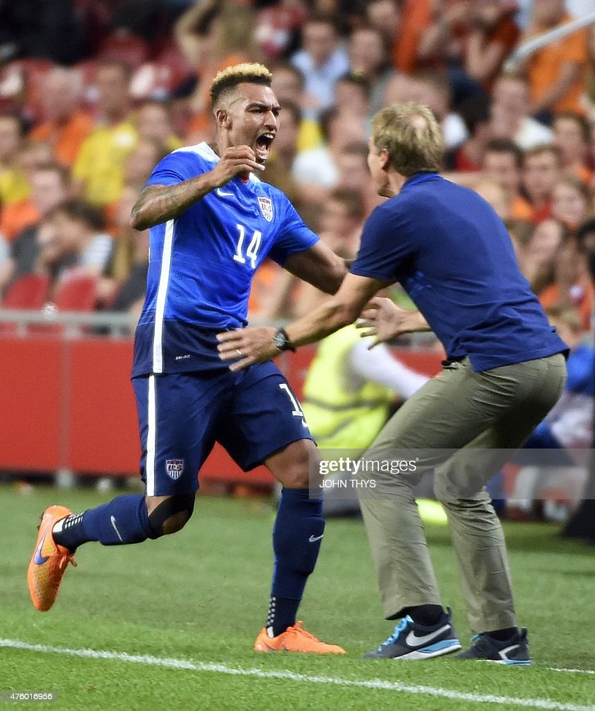 US Danny Williams celebrates with US head coach Jurgen Klinsmann after scoring a goal during the friendly football match between the Netherlands and...