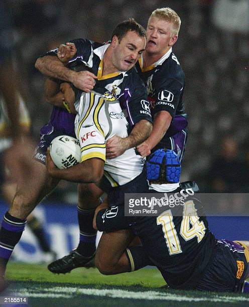 Danny Williams for the Storm tackles Ty Williams the Cowboys during the round 18 NRL match between the Melbourne Storm and the North Queensland...