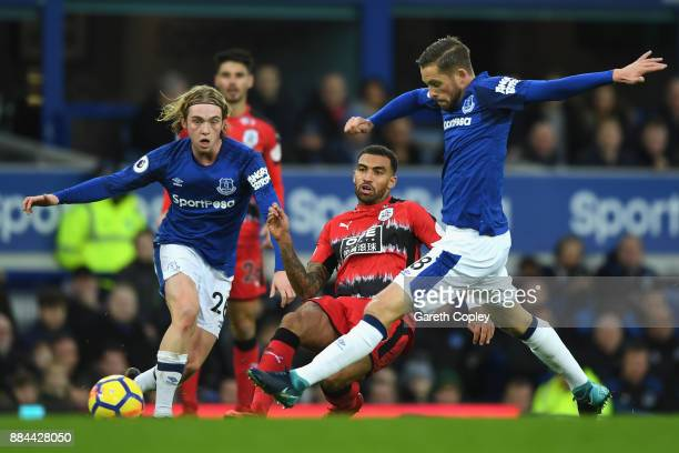 Danny Williams of Huddersfield Town shoots as Gylfi Sigurdsson of Everton attempts to block during the Premier League match between Everton and...