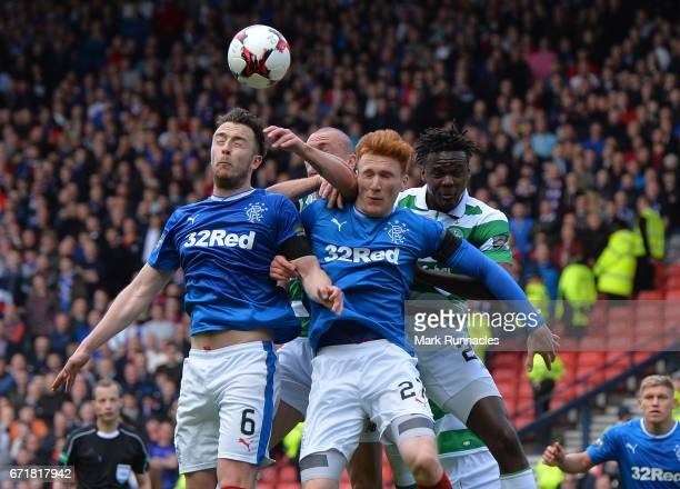 Danny Wilson and Patrick Roberts of Rangers challenge Scott Brown and Dedryck Boyata of Celtic during the William Hill Scottish Cup SemiFinal between...
