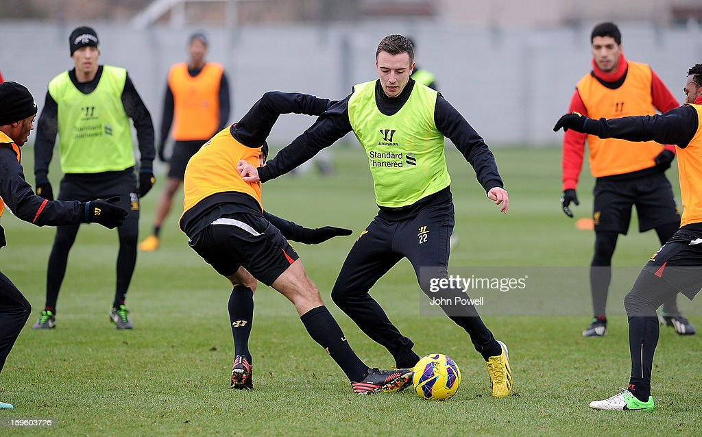 Danny Wilson and Steven Gerrard of Liverpool in action during a training session at Melwood Training Ground on January 17, 2013 in Liverpool, England.