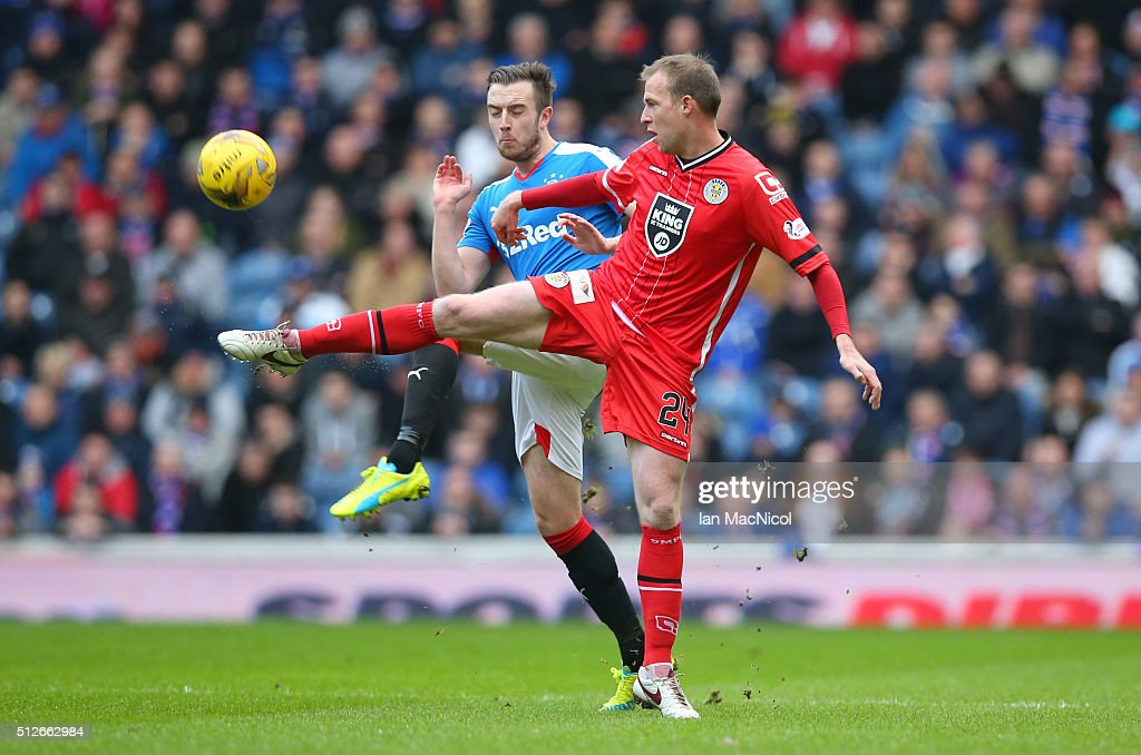 Danny Wilson of Rangers vies with David Clarkson of St Mirren during the Scottish Championship match between Rangers and St. Mirren at Ibrox Stadium on February 27, 2016 in Glasgow, Scotland.