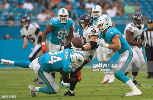 Danny Woodhead of the Baltimore Ravens loses the ball during a preseason game against the Miami Dolphins at Hard Rock Stadium on August 17 2017 in...