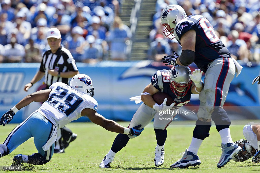 <a gi-track='captionPersonalityLinkClicked' href=/galleries/search?phrase=Danny+Woodhead&family=editorial&specificpeople=4536267 ng-click='$event.stopPropagation()'>Danny Woodhead</a> #39 of the New England Patriots tries to avoid a tackle by Ryan Mouton #29 of the Tennessee Titans during the season opener at LP Field on September 8, 2012 in Nashville, Tennessee. The Patriots defeated the Titans 34 to 13.