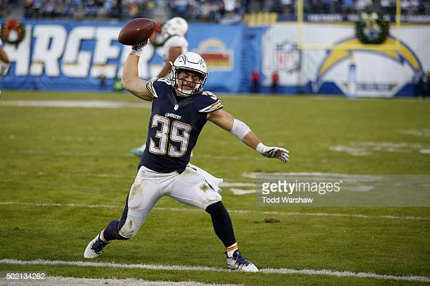 Danny Woodhead of the San Diego Chargers spikes the football after scoring his 4th touchdown of the game as the Chargers defeated the Miami Dolphins...