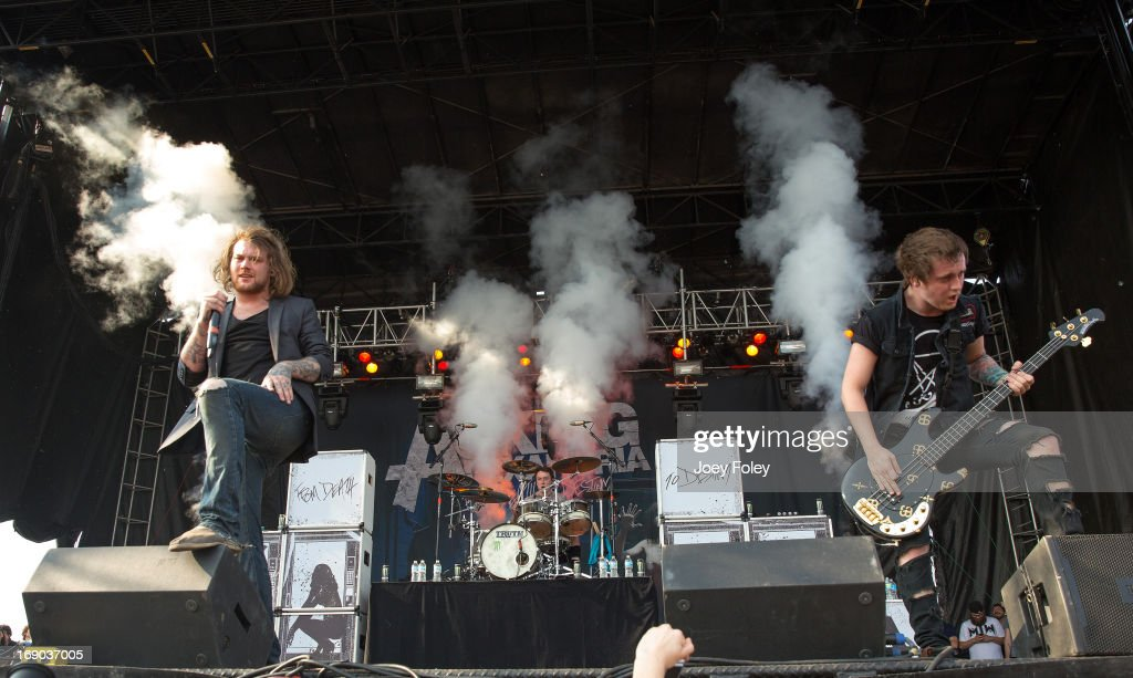 Danny Worsnop, James Cassells, and Sam Bettley of Asking Alexandria performs during 2013 Rock On The Range at Columbus Crew Stadium on May 18, 2013 in Columbus, Ohio.