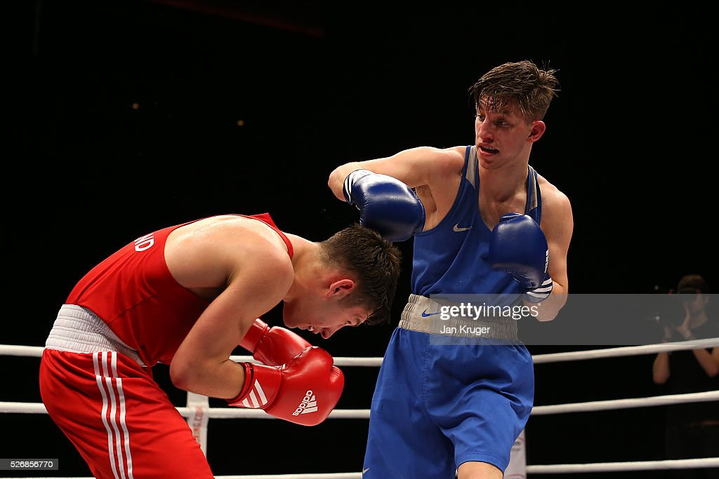 Danny Wright(red gloves) in action against Mason Smith in their 64kg final bout during day three of the Boxing Elite National Championships at Echo Arena on May 01, 2016 in Liverpool, England.