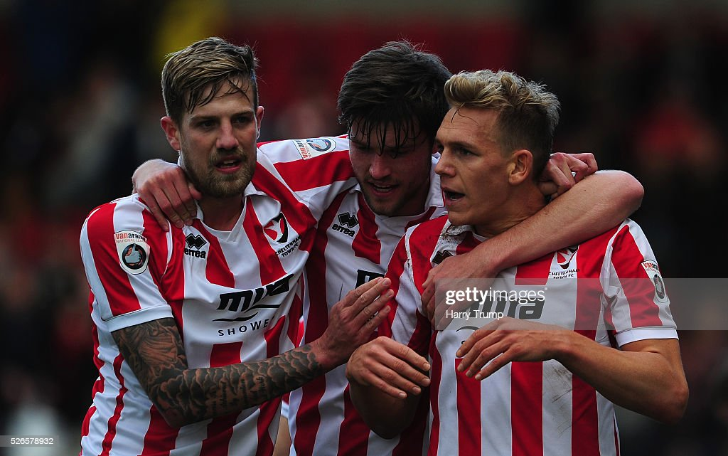 Danny Wright of Cheltenham Town(R) celebrates after scoring his sides first goal during the Vanarama Football Conference match between Cheltenham Town and Lincoln City at the World of Smile Stadium on April 30, 2016 in Cheltenham, England.
