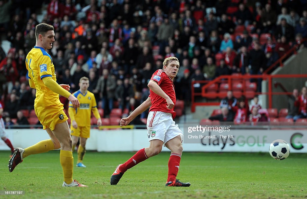 Danny Wright of Wrexham scores the opening goal during the FA Trophy Semi-Final match between Wrexham and Gainsborough Trinity at the Racecourse Ground on February 16, 2013 in Wrexham, Wales.