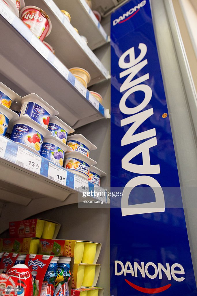 A Danone SA promotional banner sits on display beside a chilled dairy cabinet inside an OAO Dixy Group in Moscow, Russia, on Tuesday, April 8, 2014. Suppliers suffering from ruble depreciation this quarter are urging retailers to increase prices. Photographer: Andrey Rudakov/Bloomberg via Getty Images