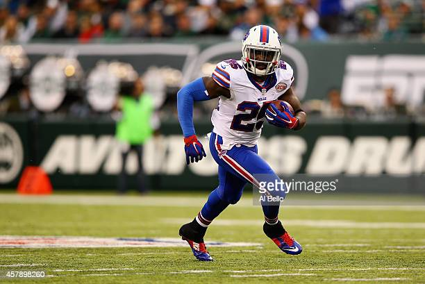 Da'Norris Searcy of the Buffalo Bills catches an interception thrown by quarterback Michael Vick of the New York Jets in the third quarter at MetLife...