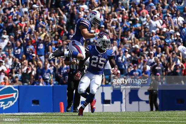 Da'Norris Searcy of the Buffalo Bills celebrates a sack with Kiko Alonso during NFL game action against the New England Patriots at Ralph Wilson...