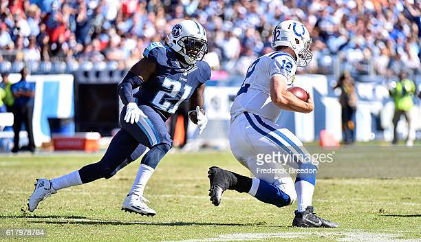 Da'Norris Searcy of the Tennessee Titans chases quarterback Andrew Luck of the Indianapolis Colts at Nissan Stadium on October 23 2016 in Nashville...
