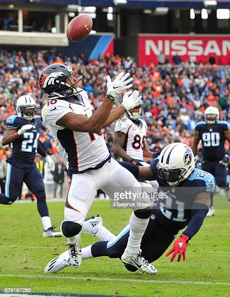 Da'Norris Searcy of the Tennessee Titans knocks the ball away from Emmanuel Sanders of the Denver Broncos during the second half at Nissan Stadium on...