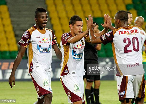 Danovis Banguero of Deportes Tolima celebrates with his teammates their victory after a second leg quarterfinal match between Atletico Huila and...