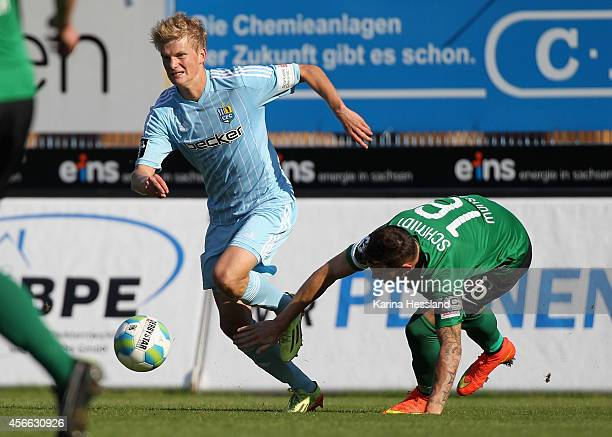 DanPatrick Poggenberg of Chemnitz is challenged by Dominik Schmidt of Muenster during the 3rd League match between Chemnitzer FC and Preussen...