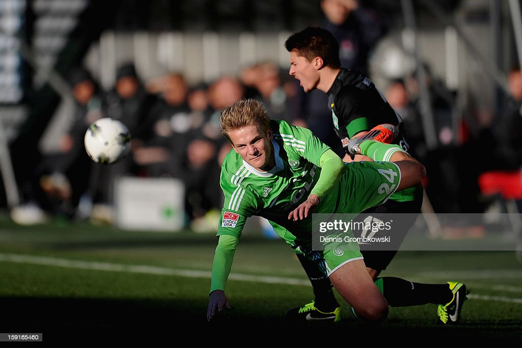 Dan-Patrick Poggenberg of Wolfsburg and Aleksandar Ignjovski of Bremen battle for the ball during the friendly match between Werder Bremen and VfL Wolfsburg at Mardan Palace Stadium on January 9, 2013 in Kundu, Turkey.