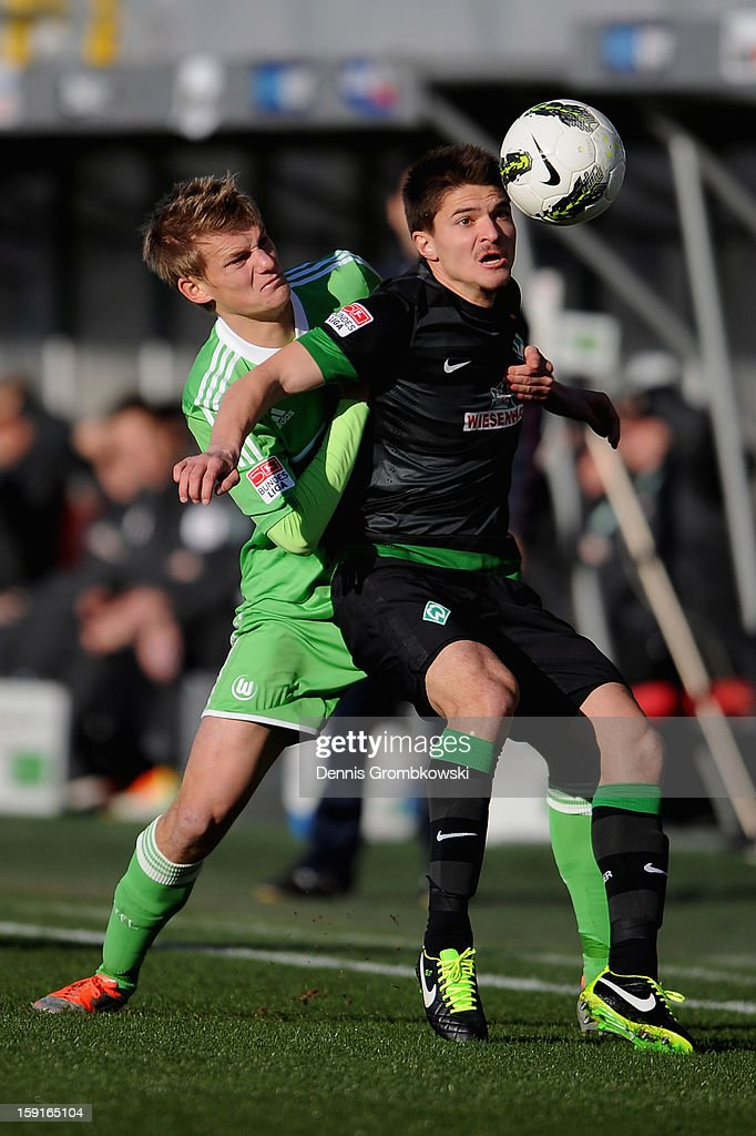 Dan-Patrick Poggenberg of Wolfsburg challenges Aleksandar Ignjovski of Bremen during the friendly match between Werder Bremen and VfL Wolfsburg at Mardan Palace Stadium on January 9, 2013 in Kundu, Turkey.