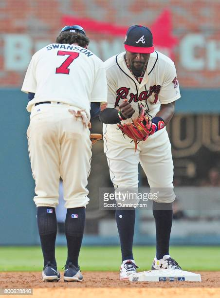 Dansby Swanson and Brandon Phillips of the Atlanta Braves celebrate after the game against the Milwaukee Brewers at SunTrust Park on June 24 2017 in...