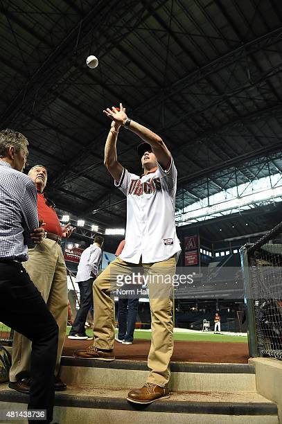 Dansby Swanson of the Arizona Diamondbacks the first overall pick in the 2015 Major League Baseball draft signs autographs prior to a game against...