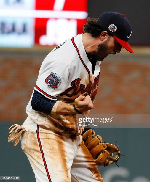 Dansby Swanson of the Atlanta Braves celebrates after catching the final out in the ninth inning of a 54 win over the Milwaukee Brewers at SunTrust...