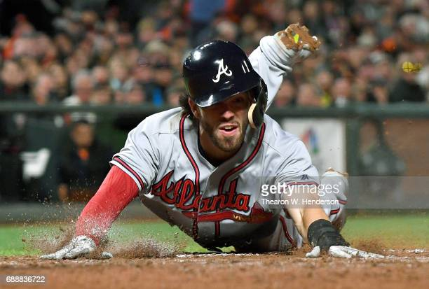 Dansby Swanson of the Atlanta Braves dives and scores against the San Francisco Giants in the top of the seventh inning at ATT Park on May 26 2017 in...