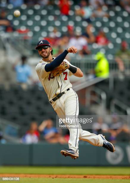 Dansby Swanson of the Atlanta Braves fields the ball of Wilmer Difo of the Washington Nationals and throws to first for the out in the fifth inning...
