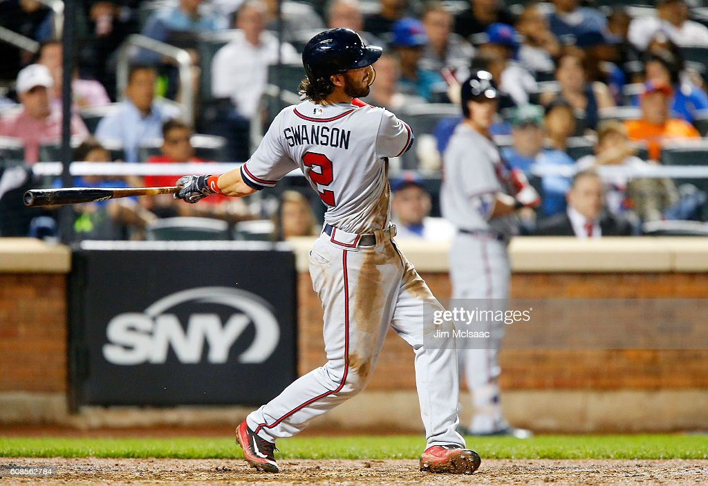 Dansby Swanson #2 of the Atlanta Braves gets a two-run base hit in the seventh inning against the New York Mets at Citi Field on September 19, 2016 in the Flushing neighborhood of the Queens borough of New York City.