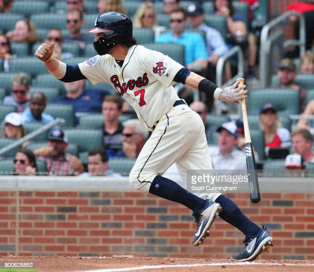 Dansby Swanson of the Atlanta Braves hits an eighth inning single against the Milwaukee Brewers at SunTrust Park on June 24 2017 in Atlanta Georgia