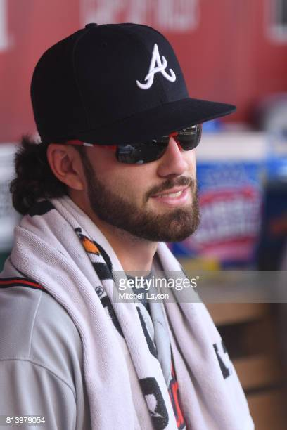 Dansby Swanson of the Atlanta Braves looks on from the dug out during a baseball game against the Washington Nationals at Nationals Park on July 8...