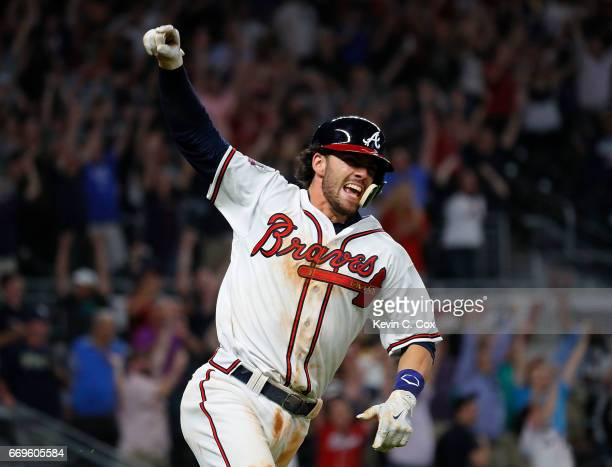 Dansby Swanson of the Atlanta Braves reacts after hitting a walkoff single to give the Braves a 54 win over the San Diego Padres in the ninth inning...