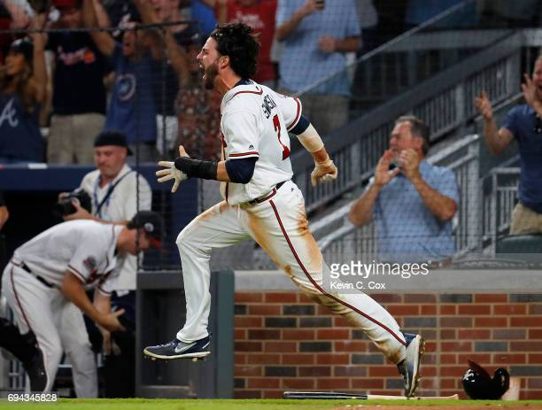 Dansby Swanson of the Atlanta Braves reacts after scoring the gamewinning run on a RBI hit by Rio Ruiz in the ninth inning against the New York Mets...
