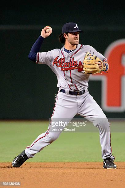 Dansby Swanson of the Atlanta Braves throws the ball to make the out at first during the first inning against the Arizona Diamondbacks at Chase Field...