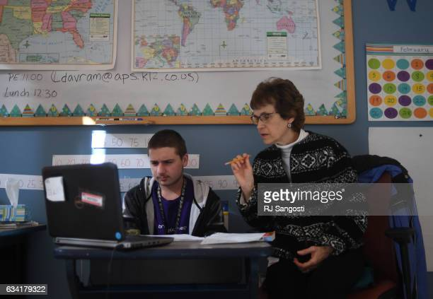 Dante Alderson a junior in high school who has a large intestine problem works with teaching assistant Darlene Farlow on math at a school at...