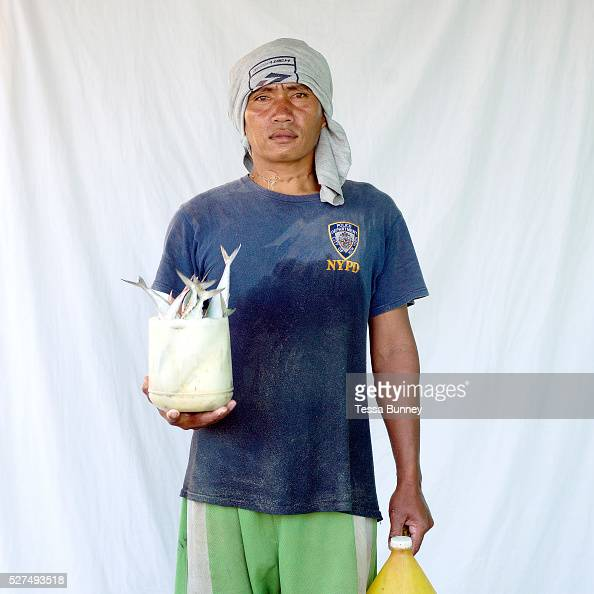 Dante Batuhan fisherman with his catch Pooc Bantayan Island The Philippines Every morning at 7 am fisherwomen meet fishermen as they return from the...